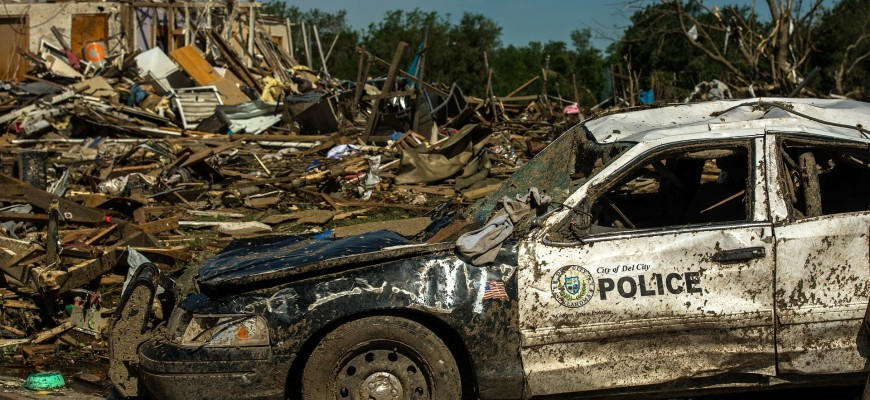 Police car severely damaged after tornado tears through the town.