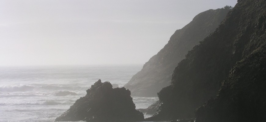 View of the Ocean with cliffs in the mist
